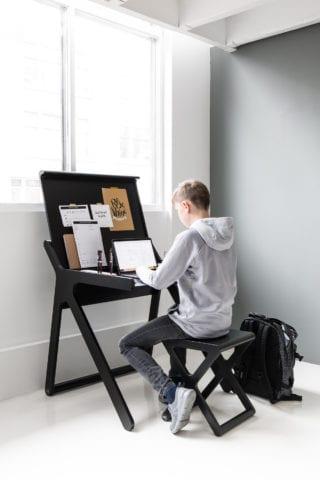Teenage boy working at Rafa-kids black K desk